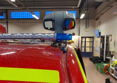 kamera på toppen af en indsatslederbil